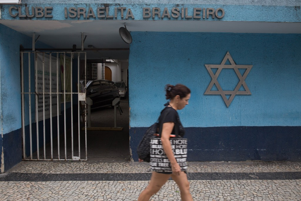 A woman walks by a Jewish community center in Rio de Janeiro, Brazil. Photo: Nati Shohat / Flash90