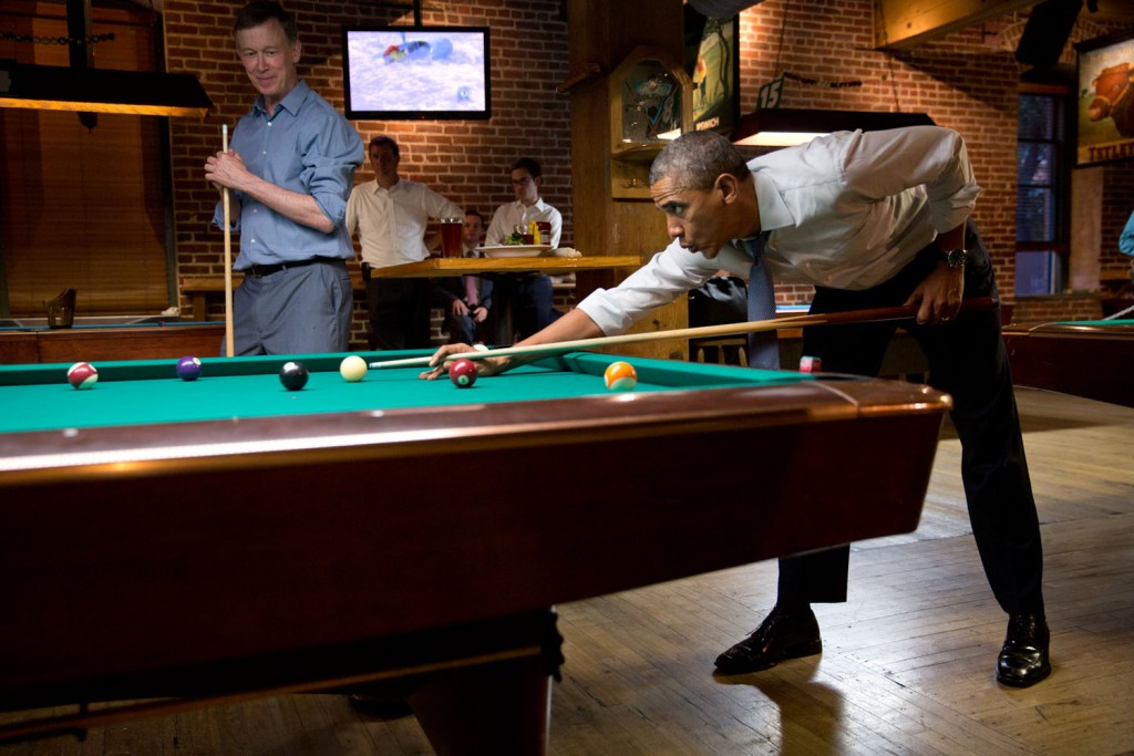 President Barack Obama plays pool with Colorado governor John Hickenlooper in Denver, July 8, 2014. Photo: Pete Souza / White House