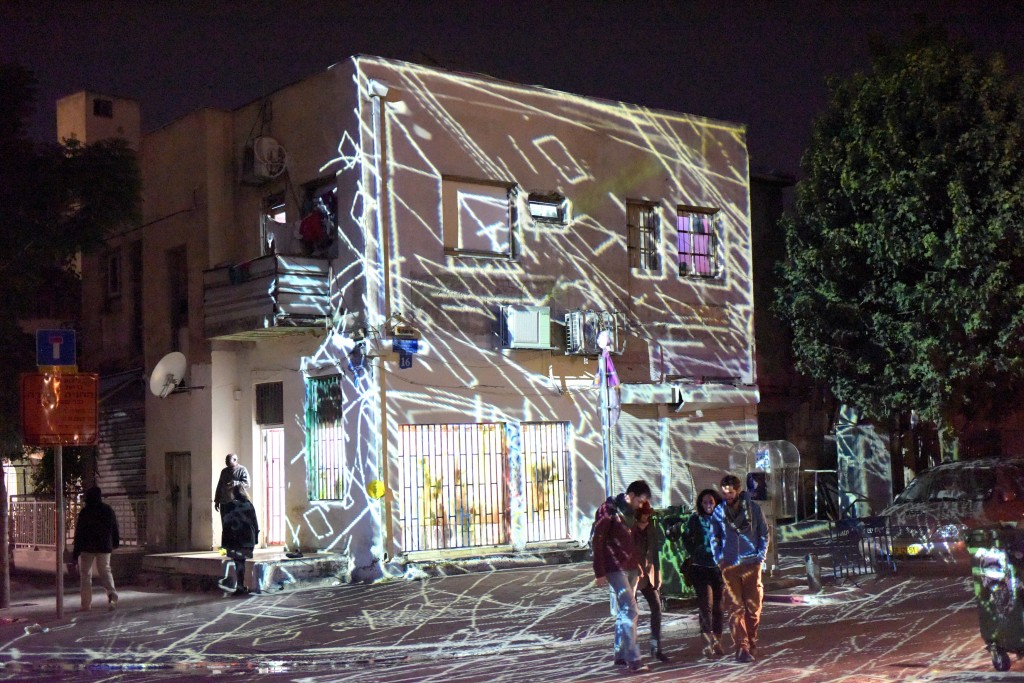 A building is lit up during a festival in Neve Sha'anan. Photo: Kfir Sivan / Tel Aviv / flickr