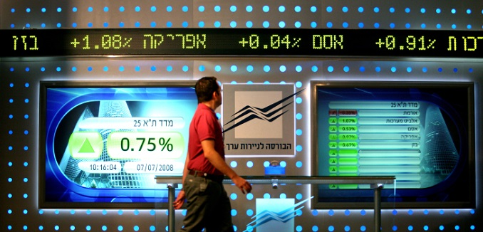 **FILE**  A man walks past a baord showing stock fluctuations at the Tel Aviv stock exchange. November 22, 2007. Photo by Moshe Shai/FLASH90  **MAARIV & AGENCIES OUT**  *** Local Caption *** ????? ????? ?? ???? ??? ????? ????? ?????? ??? ????? ???