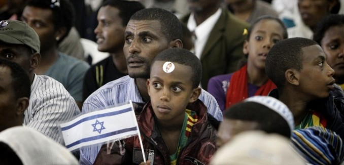 "Ethiopian Falash Mura arrive at the Ben Gurion airport, outside Tel Aviv on August 28, 2013. Some 450 new immigrants from Ethiopia were brought to Israel as part of the 'Operation Wings of Dove ' operation launched three years agoby the Jewish Agency to bring the remaining Falash Mura – Ethiopian Jews whose ancestors were forced to convert to Christianity - to Israel. Photo by Miriam Alster/Flash90.  *** Local Caption *** ???? ??? ????? ????? ??????? ???????? ??? ????? ?????  ?????  ????????  ???""?"
