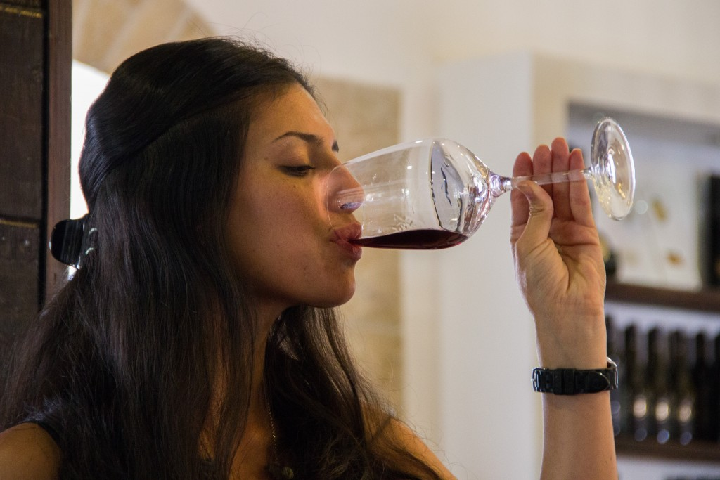 A young woman sips from her glass of wine at the Psagot winery in the West Bank. Photo: Garrett Mills / Flash90