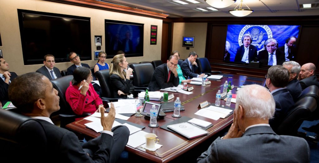 March 31, 2015: President Obama and senior advisors—including Vice President Joe Biden, National Security Advisor Susan Rice, Deputy National Security Advisor for Strategic Communications Ben Rhodes, Treasury Secretary Jack Lew, and Chief of Staff Denis McDonough—confer in the Situation Room via satellite with Secretary of State John Kerry and Energy Secretary Ernest Moniz, who were in Switzerland negotiating the Iran nuclear deal. Photo: Pete Souza / White House