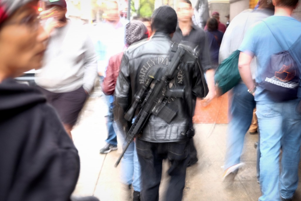 An open carry advocate walks down the street in Austin, Texas. Photo: Lars Plougmann / flickr