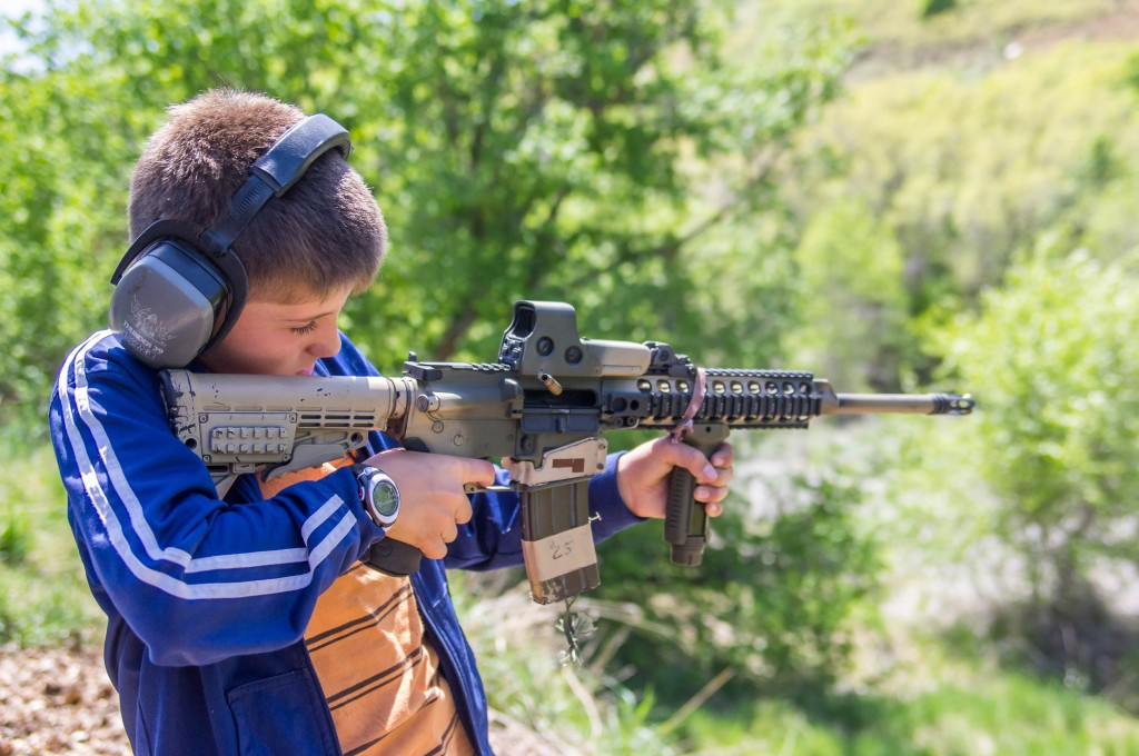 A child in Utah fires an AR-15 assault rifle. Photo: William Wootton / flickr