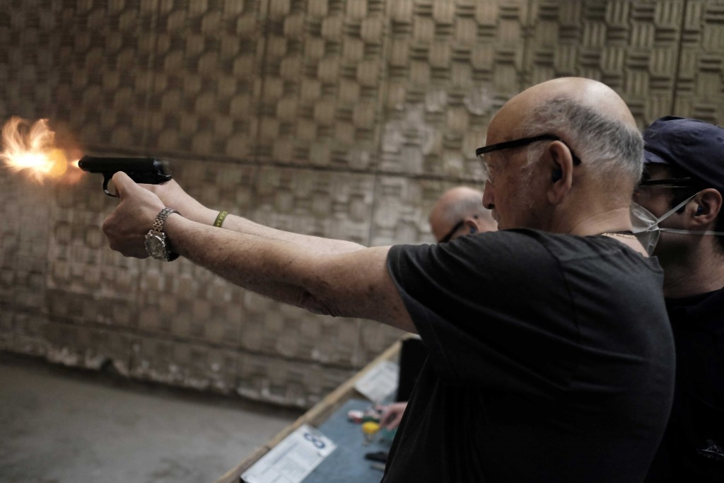Israelis practice shooting handguns at Olympic Gun Range in Herzliya. Photo: Tomer Neuberg / Flash90