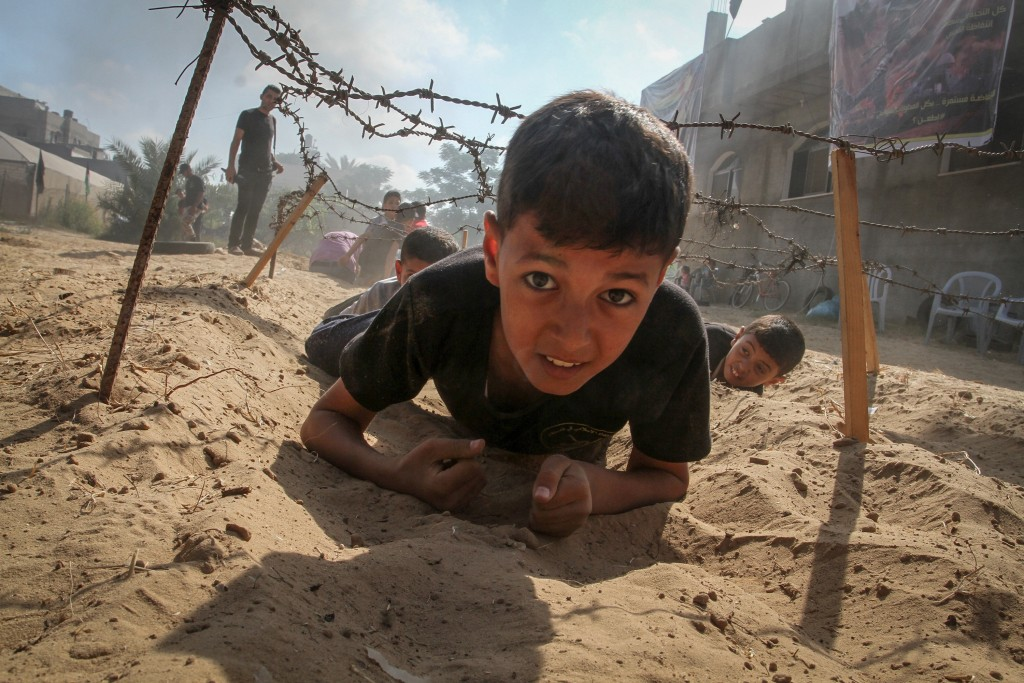 Young Palestinians take part in a military-style exercise at a summer camp organized by the Palestinian Islamic Jihad movement in Khan Yunis, Gaza Strip, July 2016. Photo: Abed Rahim Khatib / Flash90