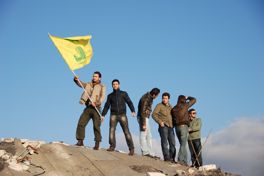 Youth in Beirut pose with the Hezbollah flag. Photo: Paul Keller / flickr