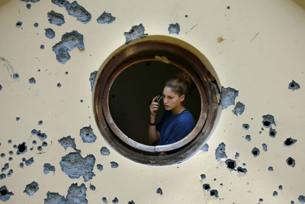 An Israeli woman checks the damage to her house after a Katyusha-style rocket attack in the northern Israeli town of Karmiel, July 15,  2006. Photo: Pierre Terdjman / Flash90