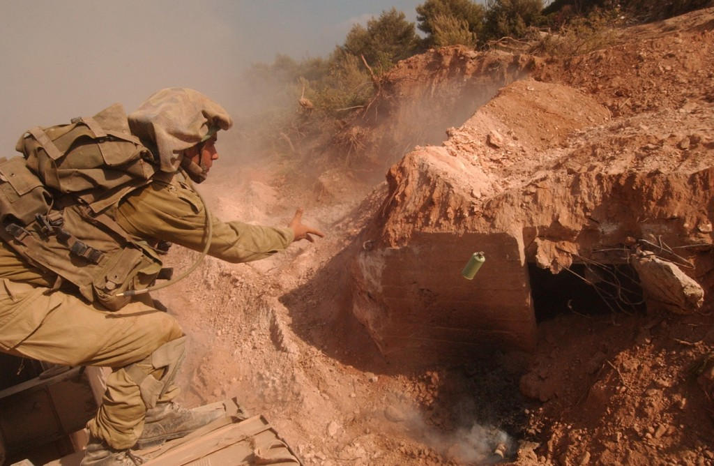 An Israeli soldier tosses a grenade into a Hezbollah bunker. Photo: Israel Defense Forces