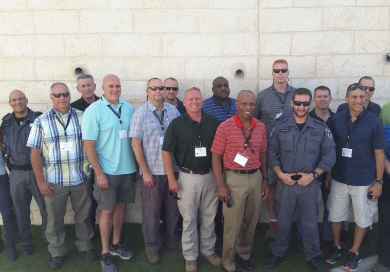 Senior U.S. law enforcement officials with Israeli counterparts in Jerusalem