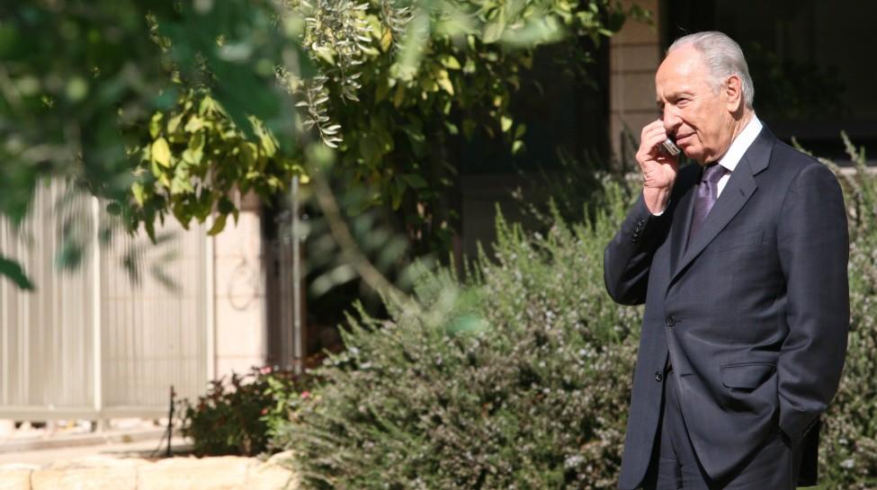 PresidentShimonPerestalks on his cell phone outside his residence, October 29,2007. Photo: Maya Levin / Flash90