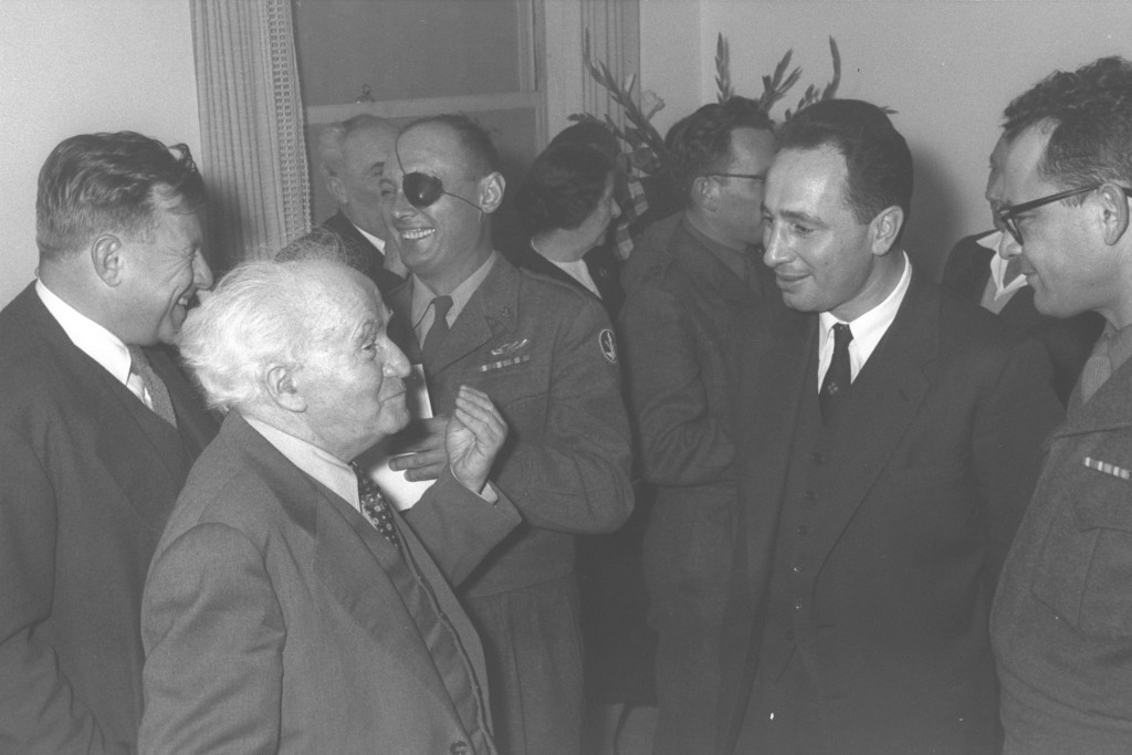 From left to right: Prime Minister's Office director-general and future Jerusalem mayor Teddy Kollek, Prime Minister David Ben-Gurion, IDF Chief of Staff and future Defense and Foreign Minister Moshe Dayan, and Defense Ministry director-general and future prime minister and president Shimon Peres, 1958. Photo: Fritz Cohen / Government Press Office
