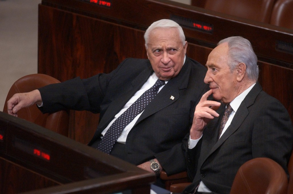 Prime Minister Ariel Sharon sits with Shimon Peres in the Knesset, January 2005. Photo: Sharon Perry / Flash90