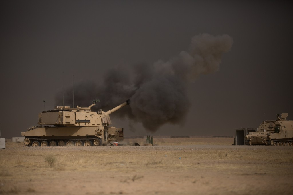 A U.S. Army M109A6 Paladin howitzer conducts a fire mission in support of the Iraqi security forces' push toward Mosul, October 17, 2016. Photo: Spc. Christopher Brecht / U.S. Army