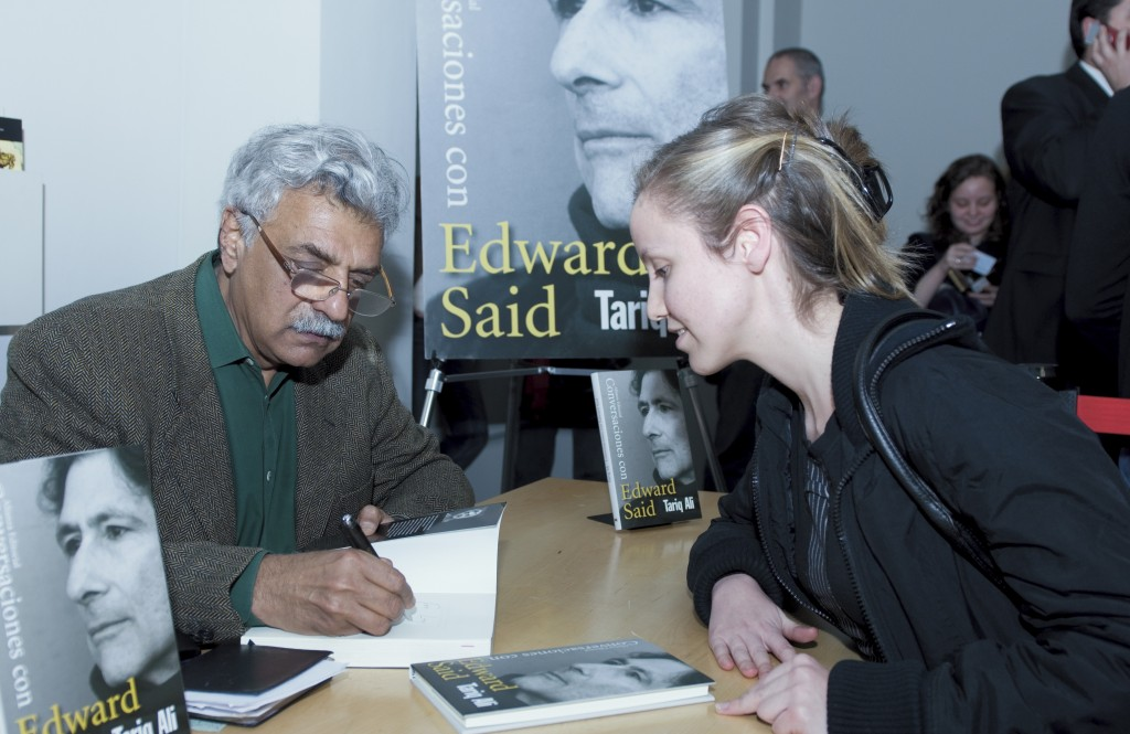 Tariq Ali signs a copy of his book Conversations with Edward Said in Cordoba, Spain. Photo: Fundación Córdoba Capital Europea de la Cultura / flickr