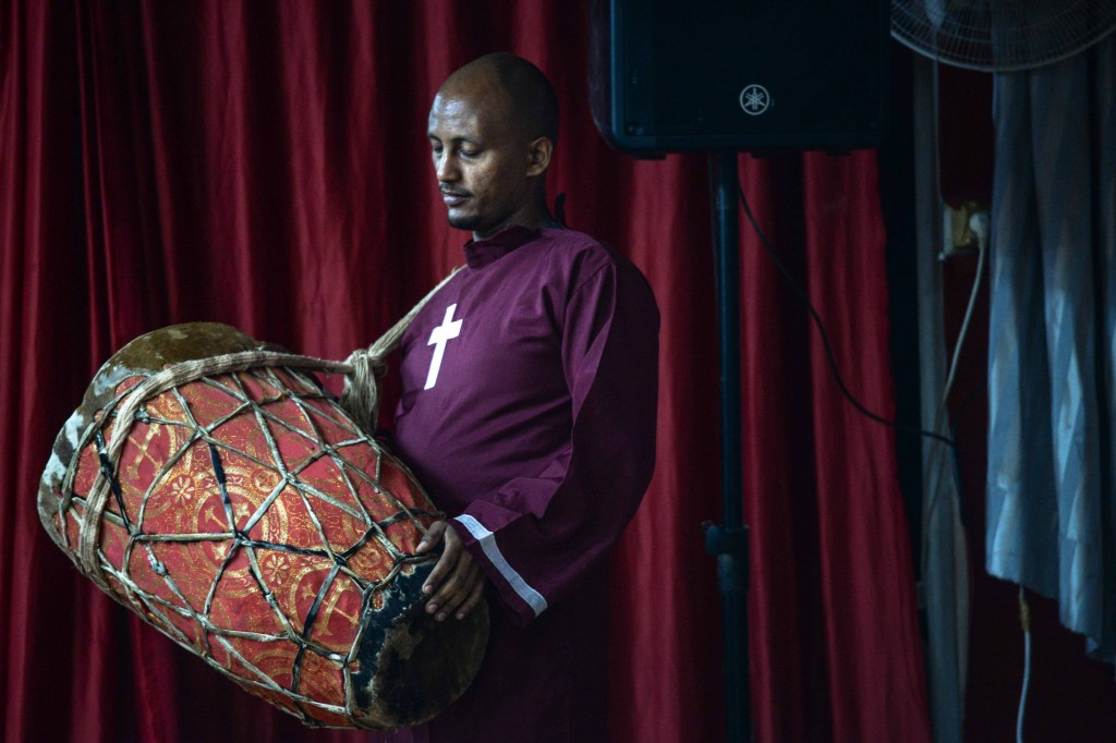 Members of the Eritrean Christian community often incorporate drumming in their services. Photo: Aviram Valdman / The Tower