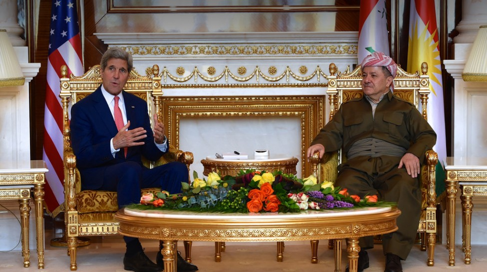 Kurdish Regional Government President Masoud Barzani listens as U.S. Secretary of State John Kerry addresses reporters at Barzani's presidential compound in Erbil, Iraq, June 24, 2014. Photo: U.S. Department of State
