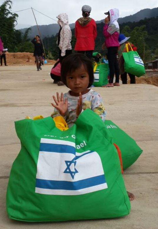 The Israeli embassy and the Family Medical Practice chain distributed bags of food and clothing to needy residents of Vietnam's In Mang But commune. Photo courtesy of Israeli Embassy in Vietnam