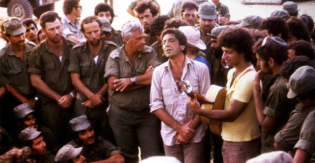 Leonard Cohen (in white) and Ariel Sharon (to his right) during the Yom Kippur War.