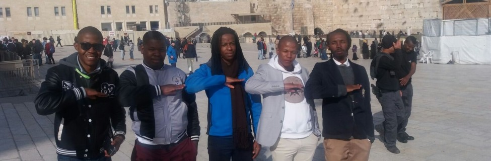 Social justice activists from Africans for Peace make the peace sign during a visit to Jerusalem's Old City. Photo: Lesiba Bapela