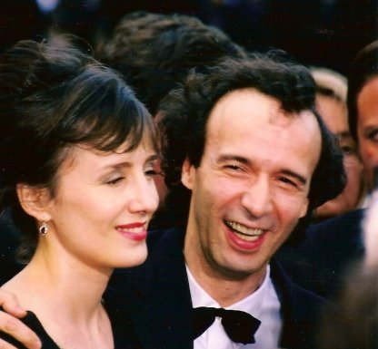 Actor-writer-director Roberto Benigni and his wife, co-star Nicoletta Braschi, at the premiere of Life is Beautiful at the 1998 Cannes Film Festival, where it won the Grand Prix. Photo: Georges Biard / Wikimedia