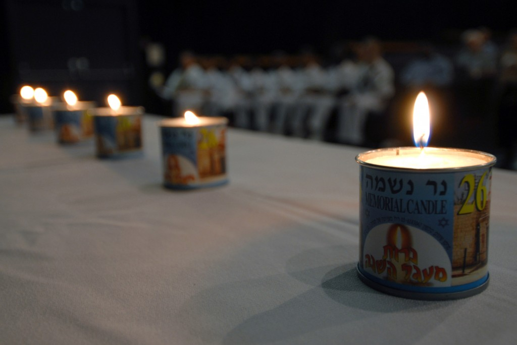 Memorial candles are lit during a Holocaust Remembrance Day ceremony at Naval Station Pearl Harbor. Photo: Mass Communication Specialist 1st Class James E. Foehl / U.S. Navy