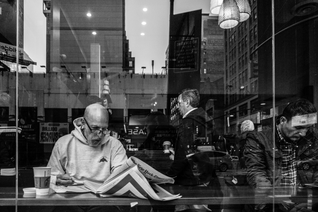 A man reads The New York Times in Manhattan. Photo: Jim Pennucci / flickr