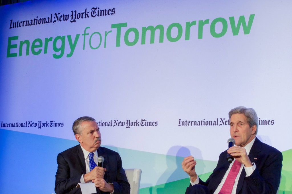 U.S. Secretary of State John Kerry chats with New York Times columnist Thomas L. Friedman during a joint appearance on December 9, 2015, at the Hotel Potocki in Paris, France, on the sidelines of the COP21 climate change conference. Photo: U.S. Department of State