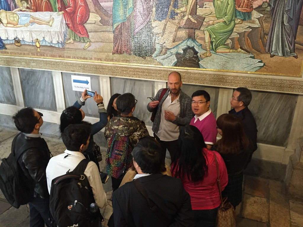 A Chinese tour group at the Church of the Holy Sepulchre in Jerusalem. Photo: Sara Toth Stub / The Tower