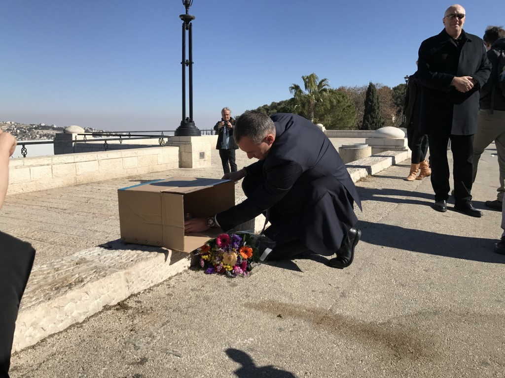 UN Special Coordinator for the Middle East Peace Process, Nickolay Mladenov, lights a candle at the site of Sundays terror attack in Jerusalem, at a memorial hosted by The Israel Project.