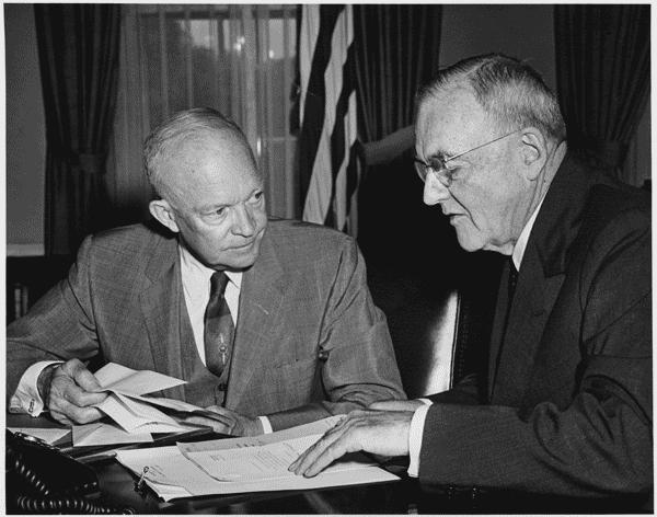 U.S. President Dwight D. Eisenhower meets with Secretary of State John Foster Dulles at the White House, August 14, 1956. Photo: National Archives Catalog