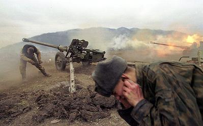 Russian artillery shell militant positions near the Chechen village of Duba-Yurt, January 2000. Photo: photographer.ru