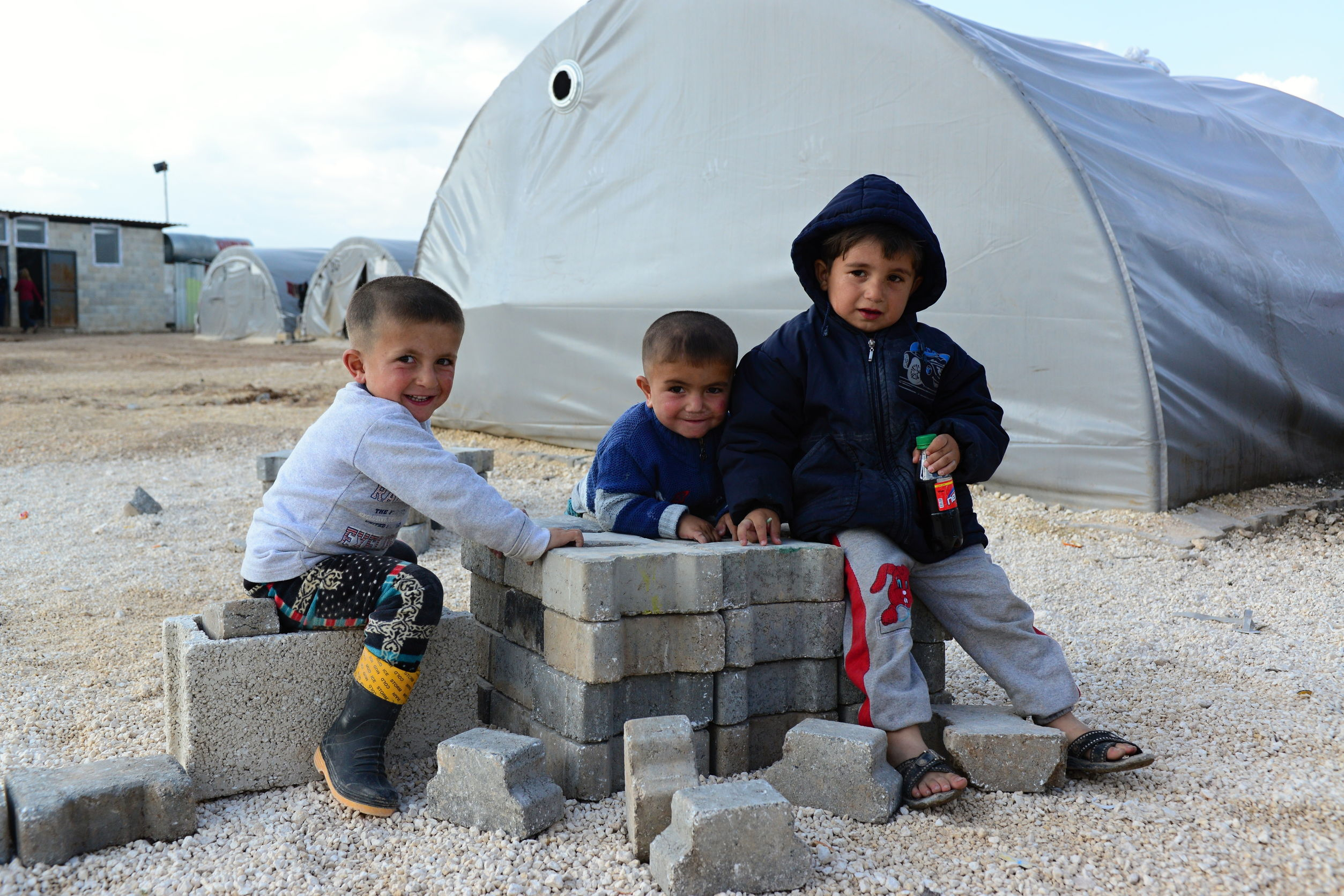 Syrian children from Kobane in a refugee camp in Suruc, Turkey. [Photo: radekprocyk / 123RF]