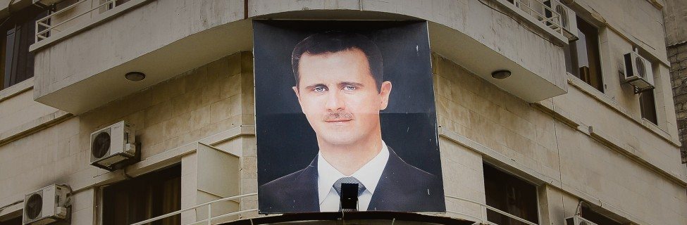 61978247 - damascus, syria - january 14, 2010:  photo of president bashar al-assad on a building in the capital city before the outbreak of the civil war