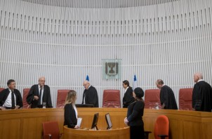 Supreme court justices and Supreme Court President Esther Hayut arrive to the courtroom of the Supreme Court in Jerusalem before the start of a court hearing about a petition asking to cancel a law allowing to stop the membership of a Member of Knesset under special circumstances. Photo by Yonatan Sindel/Flash90 *** Local Caption *** ????? ?????  ??? ???? ???? ???? ??? ???? ????? ???? ????? ???? ???? ?????