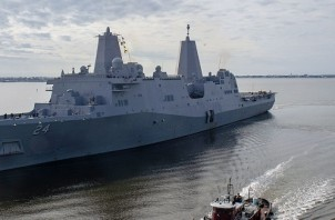 MOREHEAD CITY, N.C. (Dec. 19, 2018) The San Antonio-class amphibious transport dock ship USS Arlington (LPD 24) gets underway from Morehead City, N.C. Arlington is deploying as part of the Kearsarge Amphibious Ready Group in support of maritime security operations, crisis response and theater security cooperation, while also providing a forward naval presence. (U.S. Navy photo by Mass Communication Specialist 3rd Class Chris Roys/Released)181219-N-AT530-0031