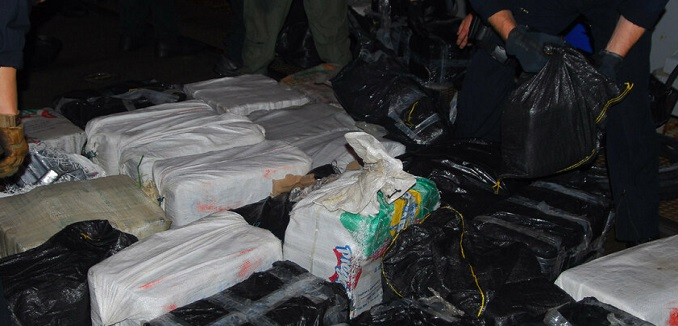 100331-N-7058E-890 PACIFIC OCEAN (March 31, 2010) U.S. Coast Guardsmen sort bales of cocaine dumped overboard by suspected drug smugglers in the waterborne mission zone of the littoral combat ship USS Freedom (LCS 1). The cocaine was dumped overboard by suspected drug smugglers in a Ògo-fastÓ vessel. Freedom seized the vessel and four suspects and recovered one ton of cocaine during counter-illicit trafficking operations in the U.S. 4th Fleet area of responsibility. (U.S. Navy photo by Lt. Ed Early/Released)